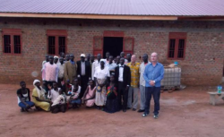 Team from Australia and Obbo people infront of MB