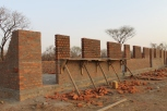 Wall raised upto window level for school
