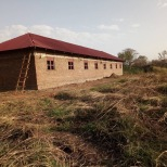 School roofing completed and borehole in use.